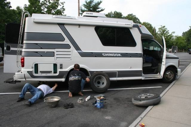 Angelo and Pat Changing the Tire