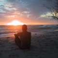 Man watching the sunset on the beach in Mal Pais, cost Rica.jpg