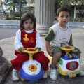 cute children on scooters at pavilion.jpg