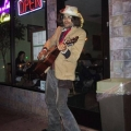 Guitar man standing on street.jpg